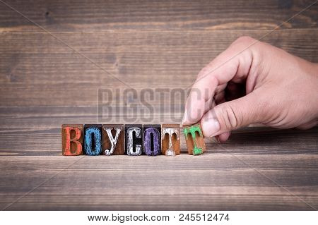 Boycott, Communication And Business Concept. Wooden Letters On The Office Desk, Informative And Comm