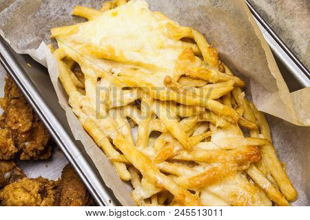 Flat Lay Above Served Fast Food. French Fries In The Paper Box. Fried Potatoes With Melted Cheese On