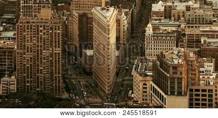New York City - SEP 11: Flatiron Building panorama closeup on September 11, 2015 in New York City. It is one of the most iconic skyscrapers and the symbol of New York City.