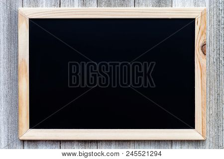 Mock Up With Black Chalkboard On Wooden Rustic Background