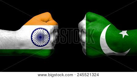 Flags Of India And Pakistan Painted On Two Clenched Fists Facing Each Other On Black Background/indi