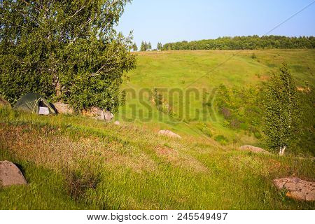 Small Tent On A Hill Ridge At Daylight Summer Andscape With Selective Focus