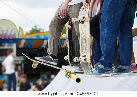Group Of Skater Boys Compete In Skate Contest Outdoor