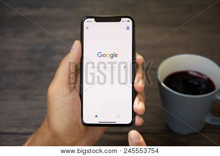 Koh Samui, Thailand - March 22, 2018: Man Holding Iphone X With Social Networking Service Google On