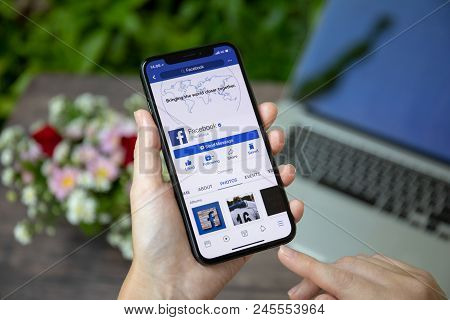 Koh Samui, Thailand - March 23, 2018: Woman Holding Iphone X With Social Networking Service Facebook