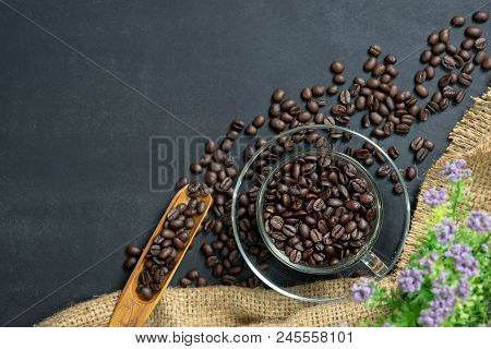 Espresso Coffee In Glass Cup. Glass Cup Of Espresso Coffee With Coffee Bean On Traditional Sack Text