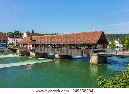 Medieval Bridge Over The Reuss River In The Town Of Bremgarten In Summertime. Bremgarten Is A Munici