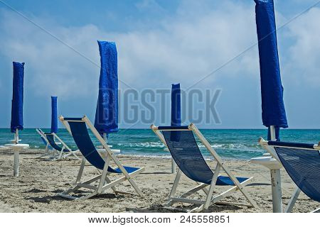 The Beach In The Area Of Alimini Waiting For Tourists. The Adriatic Coast In The South Of Italy.