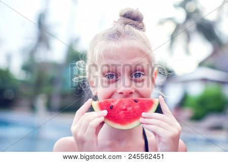 A Girl Eats A Cold Watermelon Outdoor In A Very Hot Day.concept Photo Of Hot Weather, Heat Wave, Sum