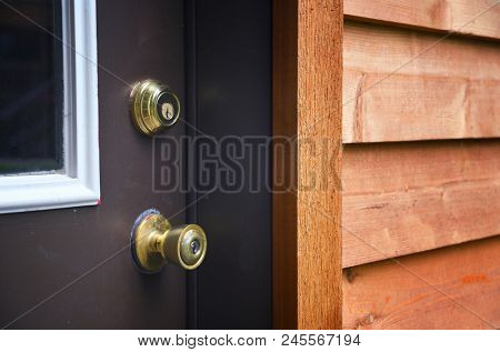 Door knob with keyhole and a deadbolt on a door