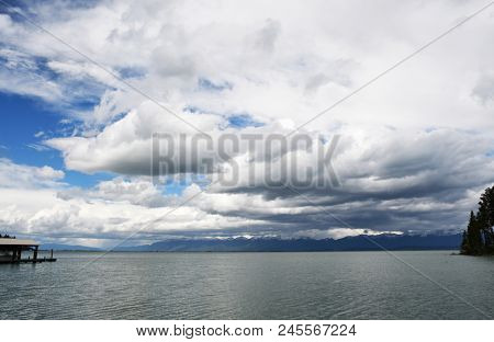 Fluffy clouds glide above Flathead Lake in Montana