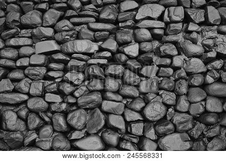 Background Texture Of Black Old Stone Wall