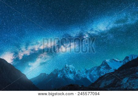 Milky Way And Snowy Mountains. Fantastic View With Mountain Ridge And Starry Sky At Night In Nepal.