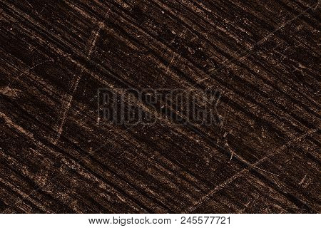 Bronze Colored Aged Surface With Dark Diagonal Stripes And Scratches. Shabby Retro Grunge Background
