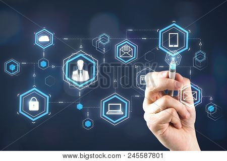 Businessman Hand Pointing At Digital Business Hologram On Blurry Background. Finance, Blockchain And