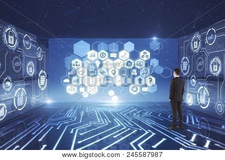 Back View Of Young Businessman Looking At Abstract Digital Business Circuit Interface. Blockchain An