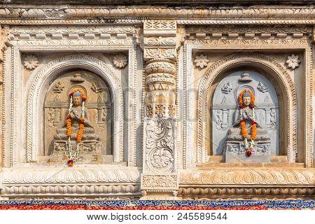 Architectural Detail With Buddha Sculptures At The Mahabodhi Temple, Bodhgaya, Bihar, India