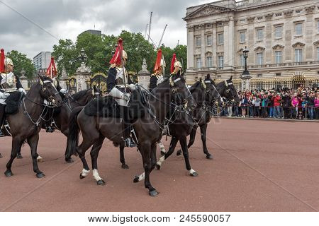 London, England - June 17, 2016: British Royal Guards Perform The Changing Of The Guard In Buckingha