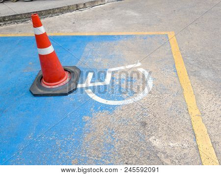 Traffic Cone On Disabled Parking. International Symbol Of Painted In Bright Blue On Center Parking S