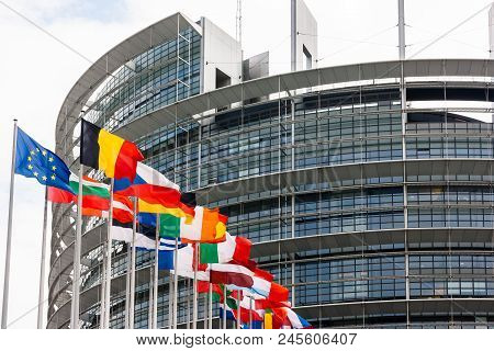 The European Parliament Building With The Flags Of The Member States Of The European Union