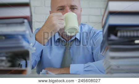 Businessperson Drink A Hot Cup Of  Tea In Office Room