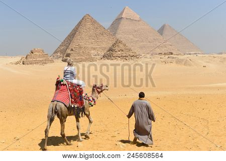 Cairo /Egypt - APRIL 03 2016: Tourists and  Giza Pyramids - Cairo, Egypt