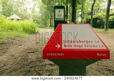 Schaarsbergen, The Netherlands - June 16, 2018: Dutch Anwb Bicycle Signpost Showing Bicycles The Way