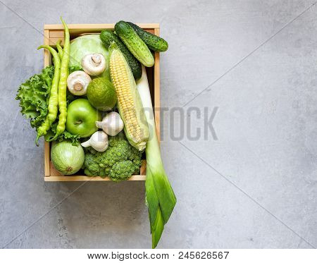 Green Vegetables Fruit In Wooden Box On Grey Background. The View From The Top . Copy Space