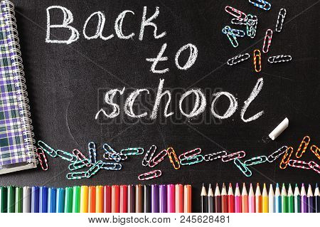 Back To School Background With Colorful Felt Tip Pens, Pencils, Clips, Notebook And The Title Back T