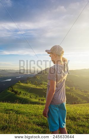 Young explorer at the sunset in Altai mountains