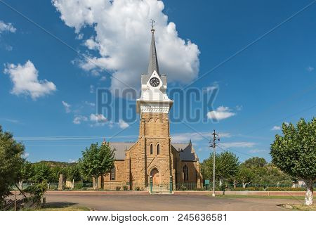 Wepener, South Africa - April 1, 2018: A Street Scene With The Historic Dutch Reformed Church In Wep