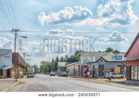 Wepener, South Africa - April 1, 2018: A Street Scene, With Businesses, People And Vehicles, In Wepe