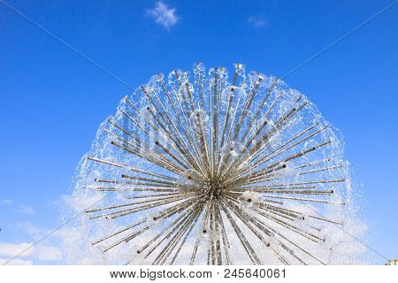 spherical fountain on blue sky background