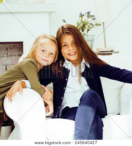 Two Cute Sisters At Home Playing, Little Girl In Interior, Lifestyle People Concept