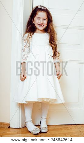 Little Cute Girl At Home, Opening Door Well-dressed In White Dress And Tiara, Adorable Milk Fairy Te