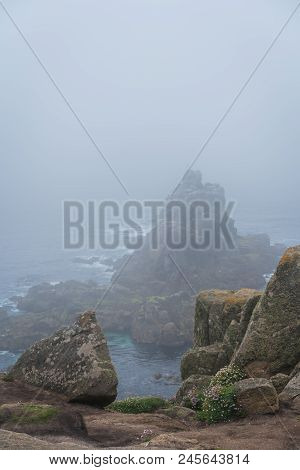 Large Boulders On The Coast Of The Lands End - The Most Westerly Point Of England Which Is A Popular