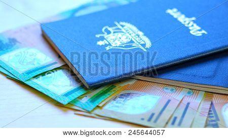 Australian Passport And Cash Travel Concept Closeup Macro Shot, With Hundred And Fifty Dollar Bills,