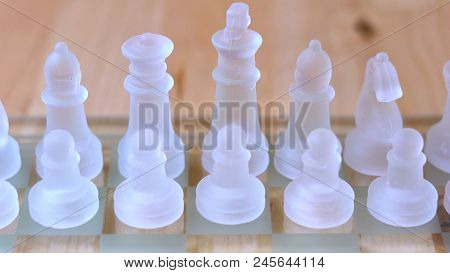 Chess Game Business Concept With Glass Pieces In Natural Light, Shallow Dof.