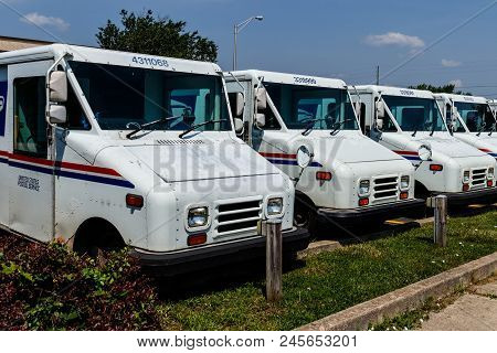 Logansport - Circa June 2018: Usps Post Office Mail Trucks. The Post Office Is Responsible For Provi