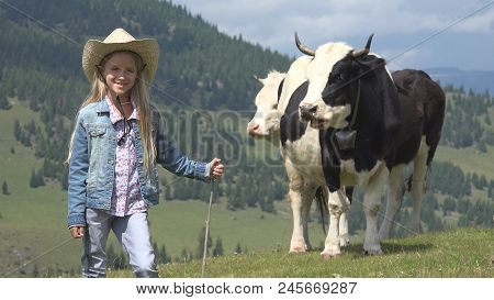 Portrait Of Smiling Farmer Child Pasturing Cows, Cowherd Girl With Cattle