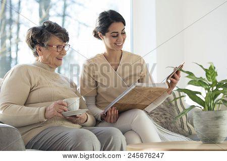 Caretaker With Elder In Room