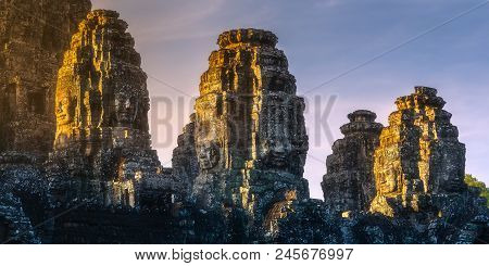 Sunrise View Of Ancient Temple Bayon Angkor Complex With Stone Faces Of Buddha Siem Reap, Cambodia