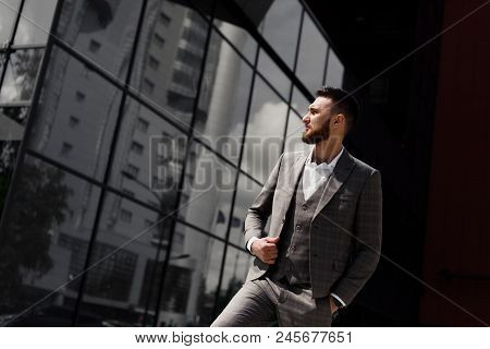Smartly Dressed Businessman, Modern Businessman. Confident Young Man In Full Suit Standing Outdoors