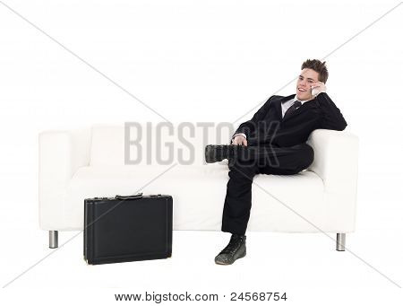 Businessman Sitting In A Sofa