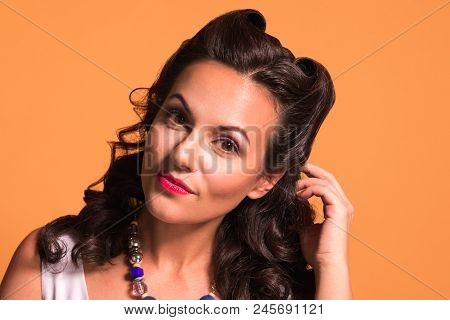 Pretty Beautiful Brunette With Hairdo And Make Up Poses In Studio, Pin Up Style, Close Up Portrait