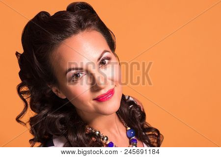 Happy Brunette With Hairdo And Make Up Poses In Studio, Pin Up Style, Close Up Portrait