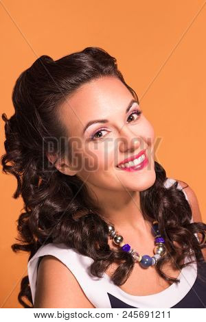 Happy Brunette With Hairdo And Make Up Poses In Studio, Pin-up Style, Close-up Portrait