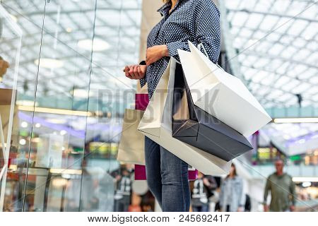 Fashion Shopping Girl Portrait. Beauty Woman With Shopping Bags In Shopping Mall. Shopper. Sales. Sh