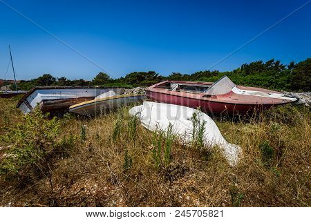 Old Abandoned Wrecked Speed Boat At Ship Or Boat Graveyard.