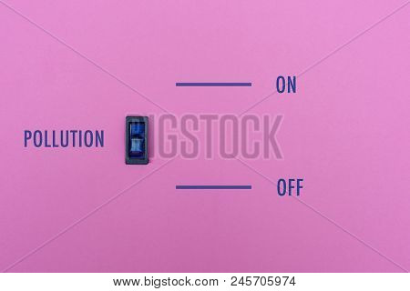 Pollution Title On A Pink Wall With A Blue Symbol Switch. We Can Stop The Pollution In Simple Way? O